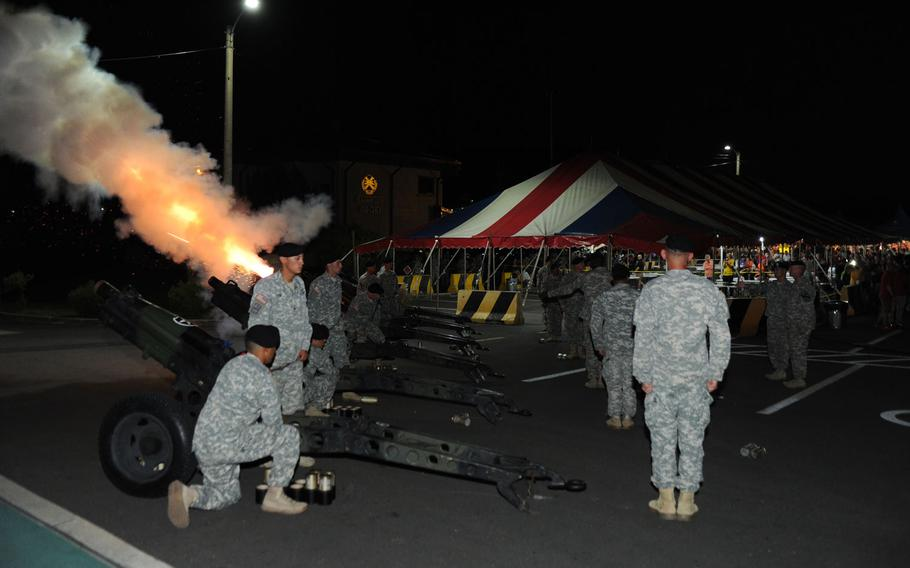 Battery C, 3rd Battalion, 16th Field Artillery Regiment fired its 75 mm howitzers on cue during the playing of the finale to Tchaikovsky's 1812 Overture at the Independence Day Celebration and Salute to the Nation Ceremony on Camp Casey, South Korea on July 4, 2015.