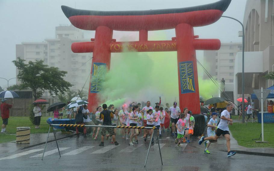 A torrential downpour could not stop the start of the four-mile Firecracker Color Run, part of Morale, Welfare, and Recreation's Yokosuka's Independence Day celebratory festivities, on board Fleet Activities (FLEACT), Yokosuka, July 3.