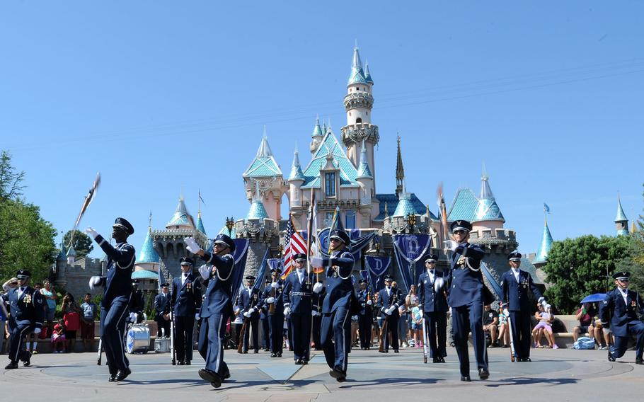 The United States Air Force Honor Guard performs at Disneyland in Anaheim, Calif., July 2, 2015. During the Fourth of July weekend each year, Disneyland invites military units to the park for special performances, a tradition started by Walt Disney on opening day.
