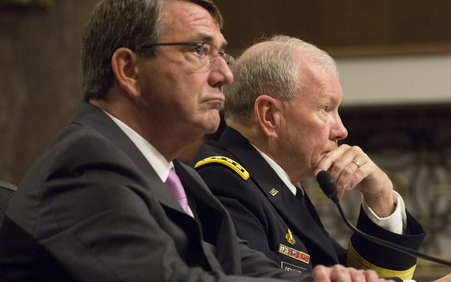 Secretary of Defense Ash Carter and Joint Chiefs of Staff Chairman Gen. Martin Dempsey listen to opening statements at a Senate Armed Services Committee hearing on counter-Islamic State strategy, July 7, 2015.