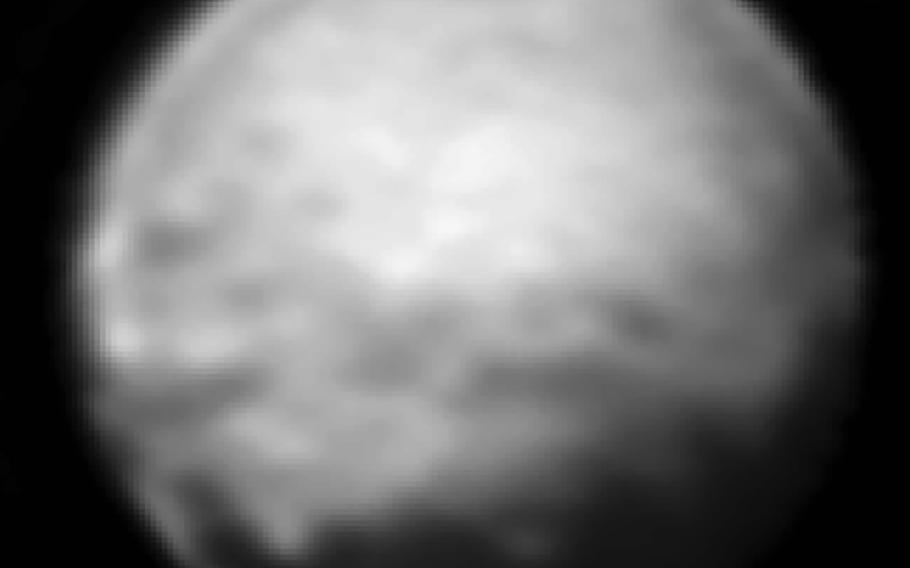 In early July, New Horizons was able to spot a continuous swath of dark terrain wrapping around the dwarf planet's equator.