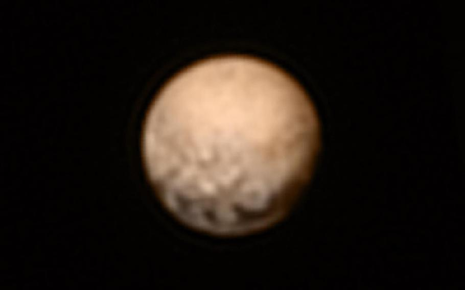 This color version of a New Horizons picture of Pluto taken July 3, 2015, was created by adding color data from the Ralph instrument gathered earlier in the mission. The craft was 7.8 million miles away.