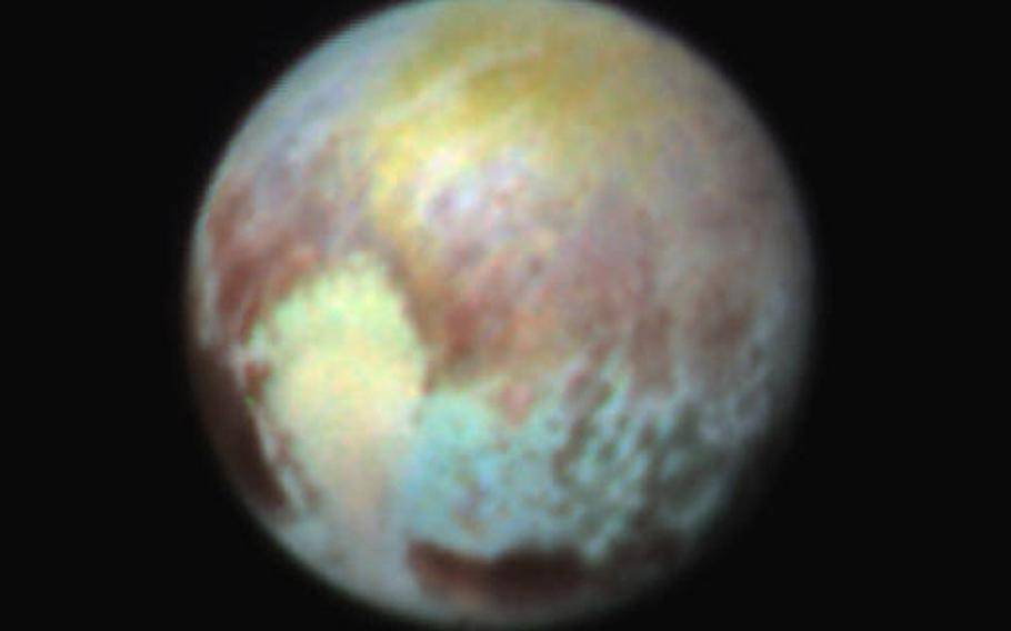 This false color composite was made to show the differences surface material. The western lobe, shaped like an ice-cream cone, appears peach color in this image. A mottled area on the right (east) appears bluish. Even within Pluto's northern polar cap, in the upper part of the image, various shades of yellow-orange indicate subtle compositional differences.