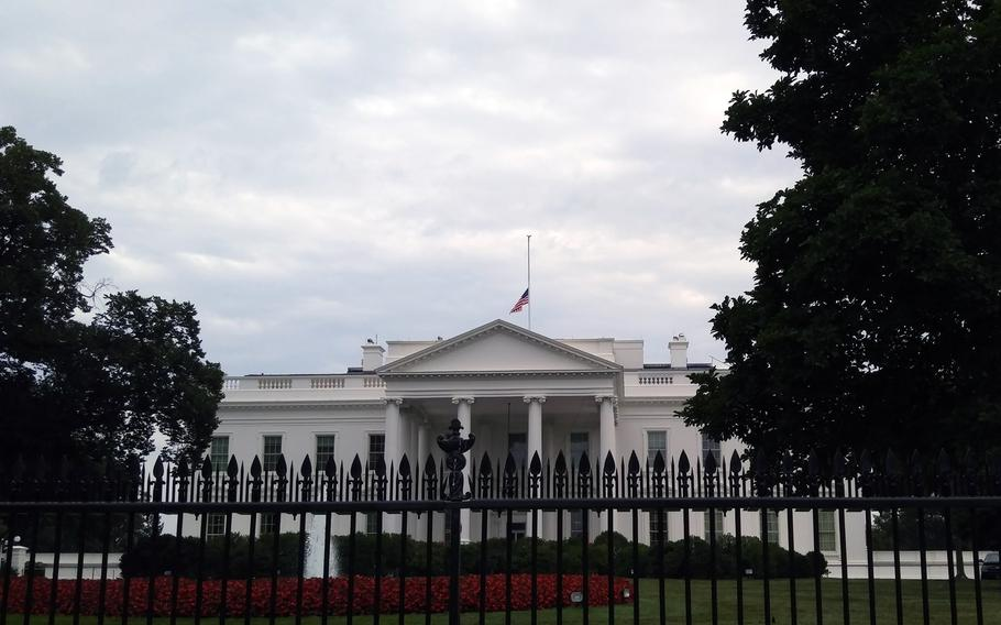 The American flag flies at half-staff at the White House in honor of the Chattanooga shooting victims on July 21, 2015.