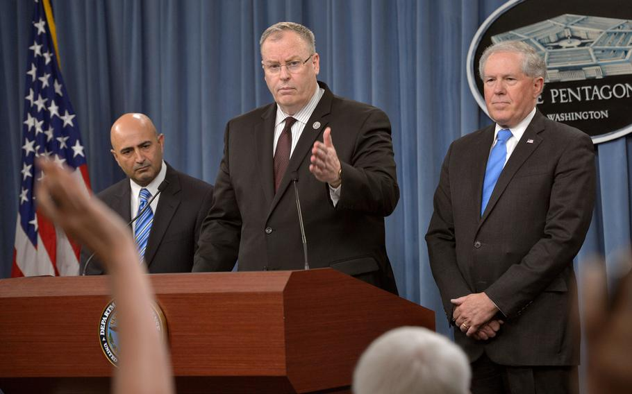 Deputy Secretary of Defense Bob Work, middle; Chairman of the Comprehensive Review Committee Dr. Vahid Majidi, left; and Under Secretary of Defense for Acquisition, Technology and Logistics Frank Kendall brief the media on the Defense Department's Comprehensive Anthrax Lab Review findings during a news conference at the Pentagon on Thursday, July 23, 2015.