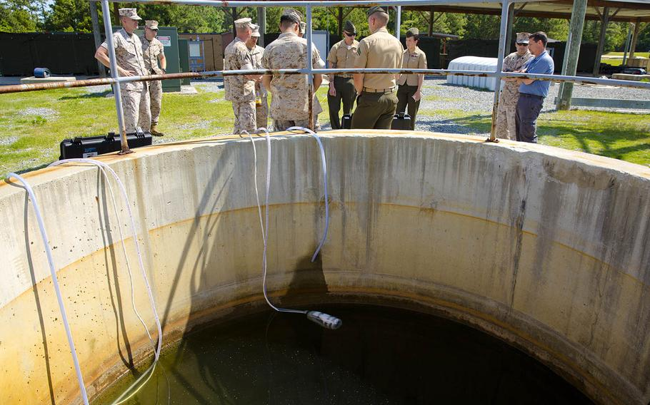 Water lines for a small unit water purification system prototype draw water from a reservoir at Camp Lejeune, N.C., May 9, 2014.