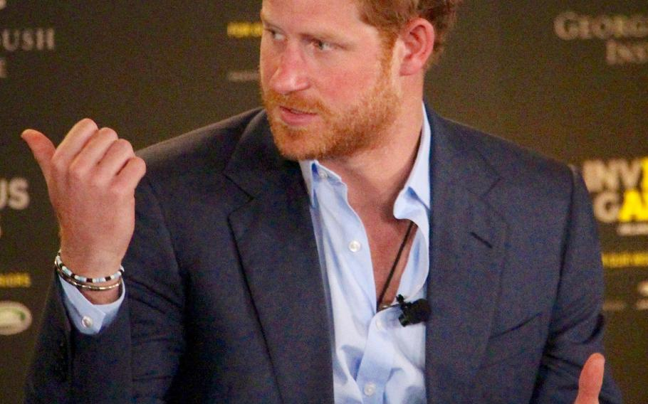 Britain's Prince Harry talks about ways to help returning servicemen who have suffered traumatic injuries on the battlefield during the 2016 Invictus Games Symposium on Invisible Wounds, Sunday, May 8, 2016 at Orlando, Fla.