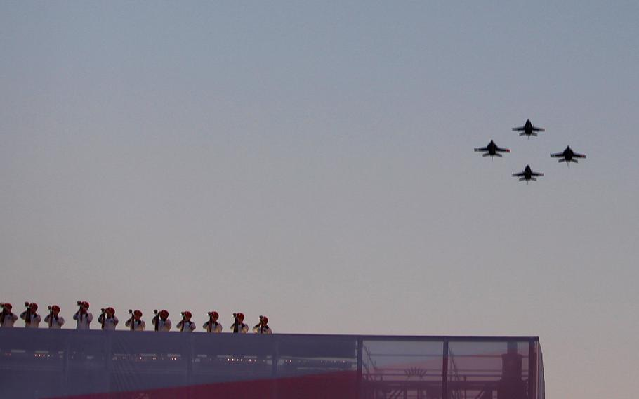 The US Navy Strike Fighter Squadron 34 fly over the crowd during the opening ceremonies of the 2016 Invictus Games at Kissimmee, Fla. on Sunday, May 8, 2016.