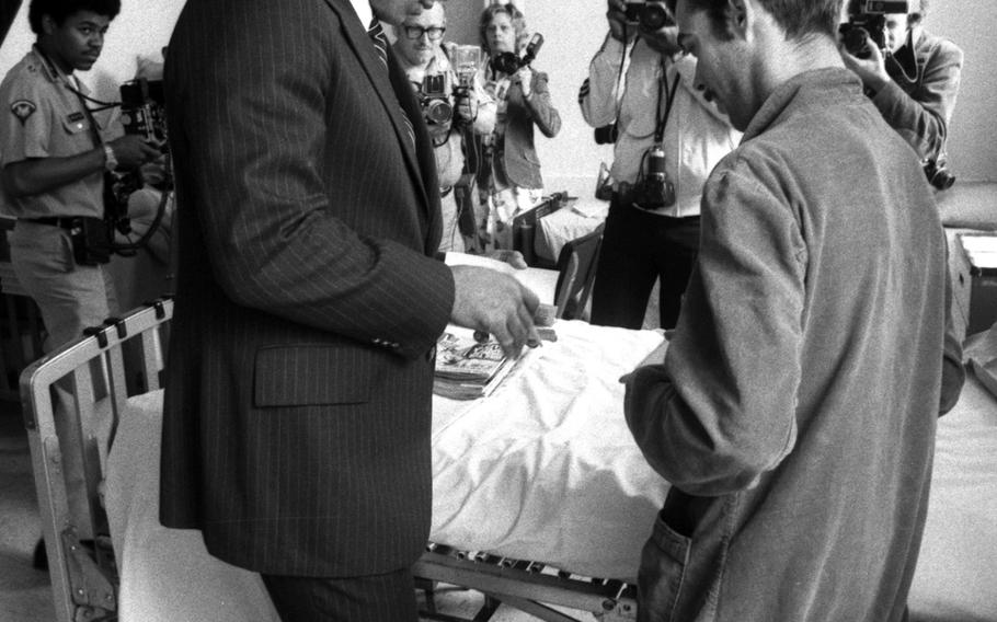 Muhammad Ali visits the hospital at Flak Casern in Augsburg, West Germany, in May, 1976.