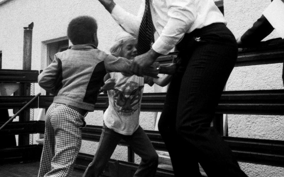 Muhammad Ali defends himself against the playful onslaught of Augsburg Elementary School pupils during a visit to Augsburg, West Germany, in May, 1976.