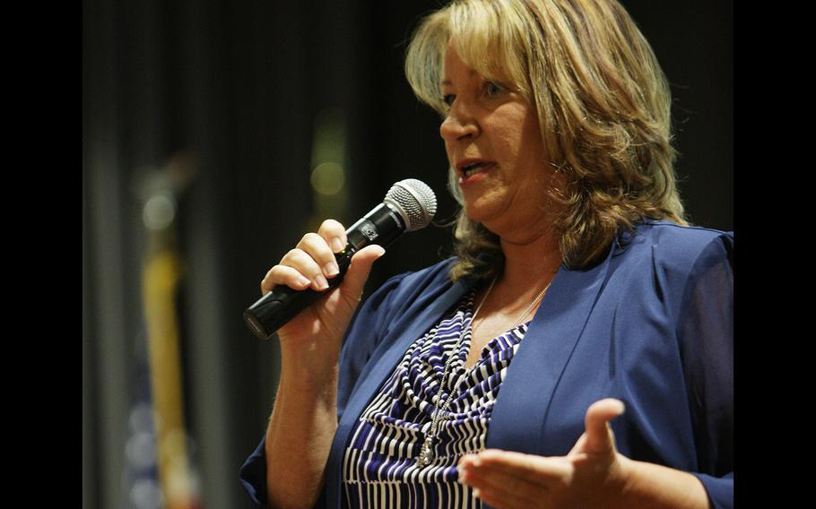Retired Lt. Col. Teresa James shares her story Thursday at the DOD Inspector General's annual whistleblower hotline conference. James was retaliated against for reporting she was raped in the West Virginia National Guard.