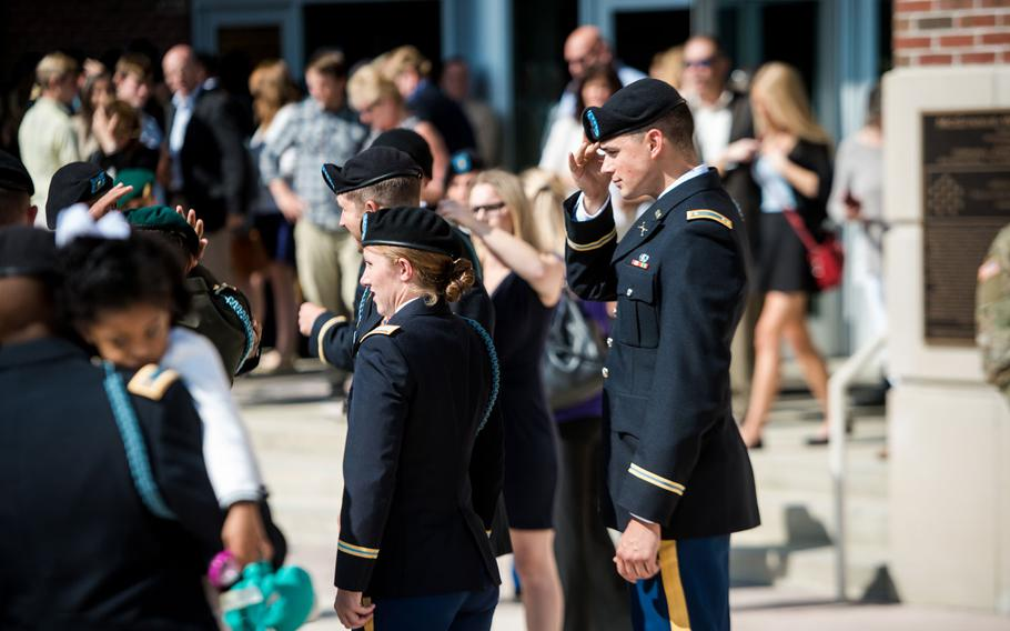 Students from the Infantry Basic Officer Leader Course celebrate with their families and fellow classmates after graduation, October 26, 2016, at McGinnis-Wickam Hall in Fort Benning.