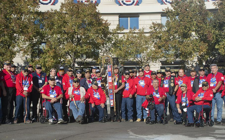 The first Native American Honor Flight flew in from Nevada and spent Veterans Day in Washington, D.C. Here they post at the US Navy Memorial.