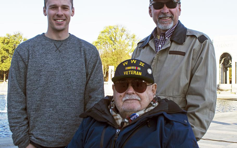 Virginia firefighter Steve Soloduk, top left, poses with his father Warren and his grandfather Fred on Veterans Day 2016 on the National Mall in Washington, D.C. Fred Soloduk, 91-years-old, served in the U.S. Navy on the USS Carter in the Atlantic Theater. Warren Soloduk is retired Coast Guard.