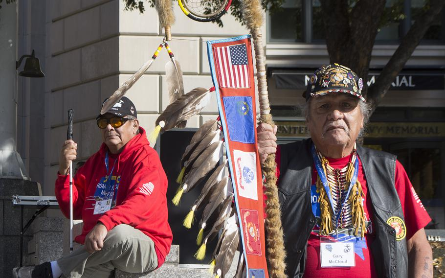 Gary McCloud, right, a retired Marine corporal, relaxes at the U.S. Navy Memorial on Veterans Day in Washington. In the background is Ed Dick. Both men were part of the first all Native American Honor Flight out of Nevada on Nov. 10.