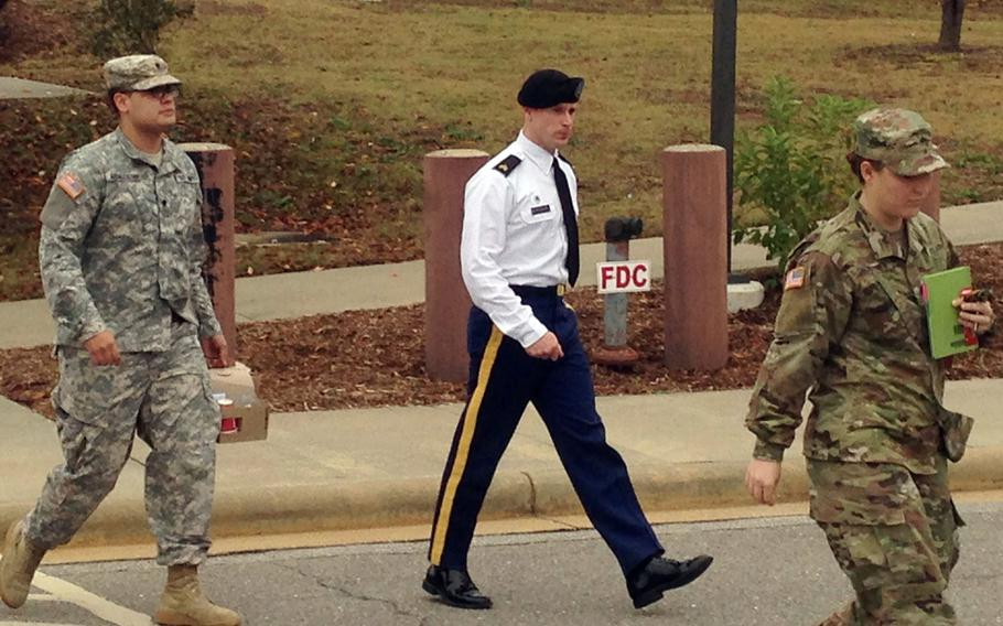 Army Sgt. Bowe Bergdahl is seen leaving a courtroom after a pretrial hearing in Fort Bragg, NC., Monday, Nov. 14, 2016. Bergdahl faces a military trial in 2017 on charges of desertion and misbehavior before the enemy after walking off his post in Afghanistan in 2009.