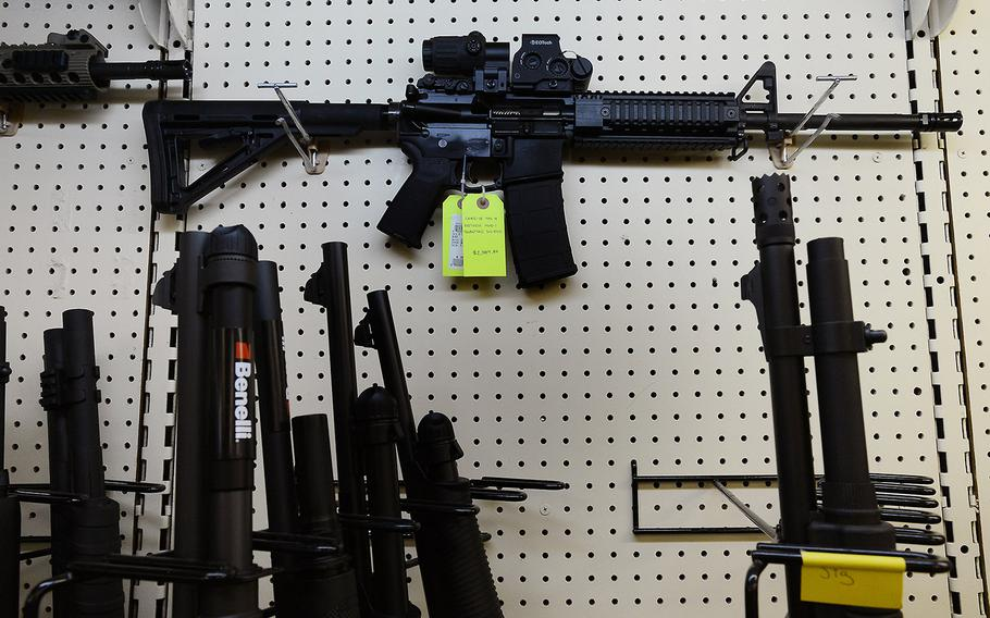 An AR-15 assault rifle featuring an EoTech optical sighting system and a 30-round magazine capacity is seen in a gun shop in North Carolina.
