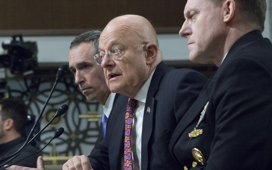 Director of National Intelligence James R. Clapper, Jr., center, makes a point during a Senate Armed Services Committee hearing on cybersecurity, Jan. 5, 2017, on Capitol Hill. To his right is Under Secretary of Defense for Intelligence Marcel J. Lettre II, and to his left National Security Agency Director Adm. Michael S. Rogers.