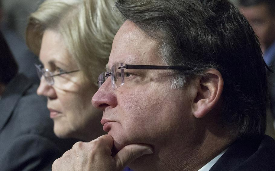 Sen. Gary Peters, D-Mich. , one of four new members of the Senate Armed Services Committee, listens to testimony during a hearing on cybersecurity, Jan. 5, 2017, on Capitol Hill. Next to him is another new committee member, Sen. Elizabeth Warren, D-Mass.