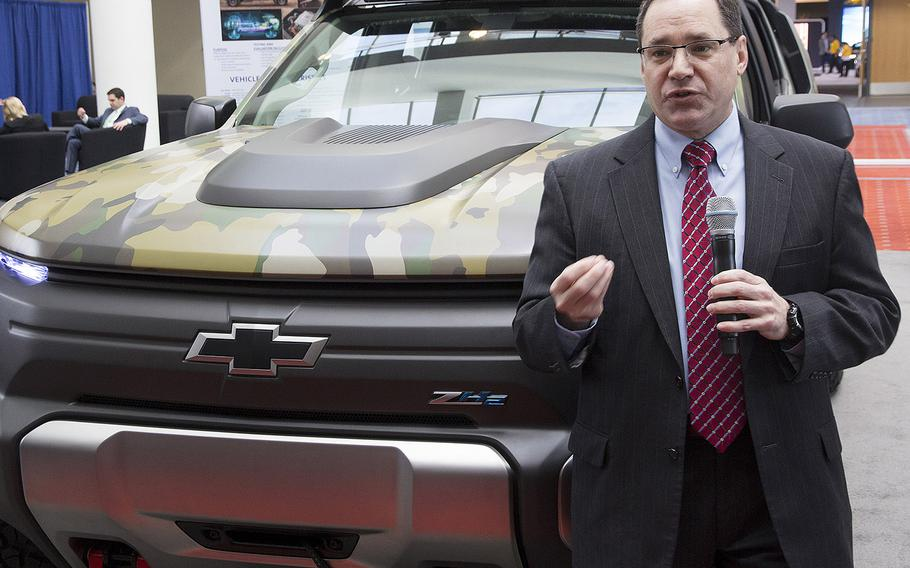 Dr. Paul Rogers, director of the U.S. Army's Tank Automotive Research, Development and Engineering Center (TARDEC), stands next to the ZH2 Fuel Cell Electric Vehicle as he talks to reporters at the Washington Auto Show, Jan. 26, 2017.