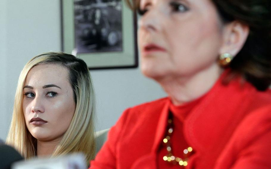 In a March 8, 2017 file photo, active-duty Marine Marisa Woytek, left, and attorney Gloria Allred announce at a Los Angeles press conference that photos of Woytek and of another former female Marine were secretly posted online without their consent.