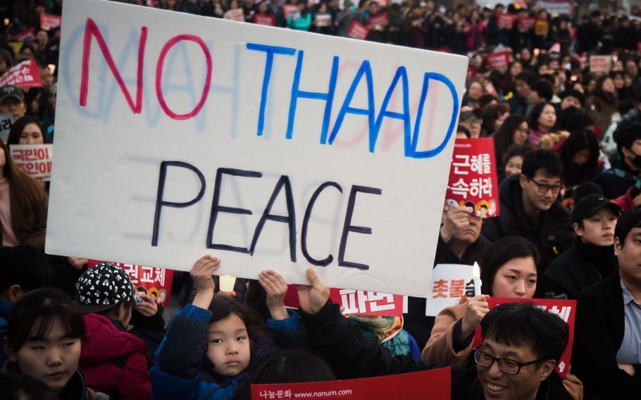 South Koreans celebrate the impeachment of President Geun-hye Park at Gwanghwamun Square, Seoul, South Korea, Saturday, March 11, 2017.