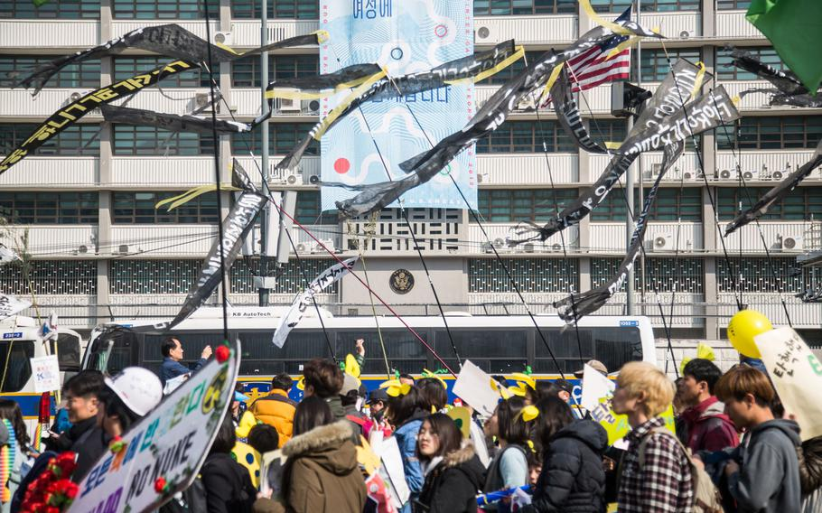 South Koreans protest an advanced anti-missile system, known as THAAD, during a rally celebrating the impeachment of President Geun-hye Park at Gwanghwamun Square, Seoul, South Korea, March 11, 2017.
