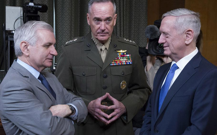 Secretary of Defense Jim Mattis, right, talks with Sen. Jack Reed, D-R.I., and Joint Chiefs of Staff Chairman Gen. Joseph Dunford before a Senate Appropriations Committee hearing on Capitol Hill, March 22, 2017.