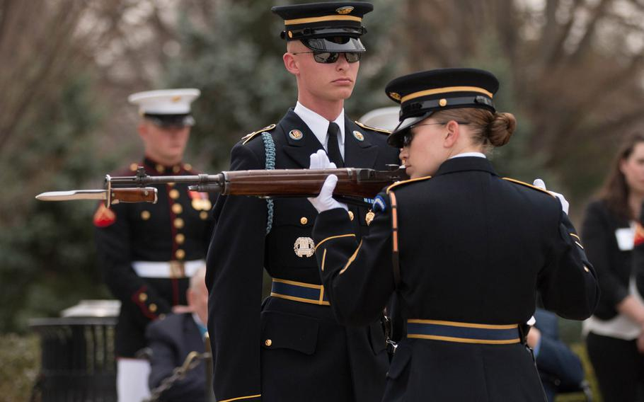 """Soldiers with the U.S. Army's 3rd Infantry Regiment """"The Old Guard"""" conduct a changing of the guard inspection at the Tomb of the Unknown Soldier at Arlington National Cemetery on Saturday, March 25, 2017."""