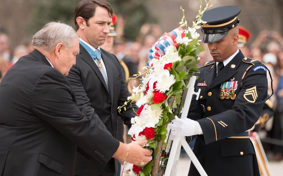 """Mike Fitzmaurice, left, and Will Swenson, center, both Medal of Honor recipients, lay a wreath with the help of a soldier with the U.S. Army's 3rd Infantry Regiment """"The Old Guard""""at the Tomb of the Unknown Soldier at Arlington National Cemetery on Saturday, March 25, 2017."""
