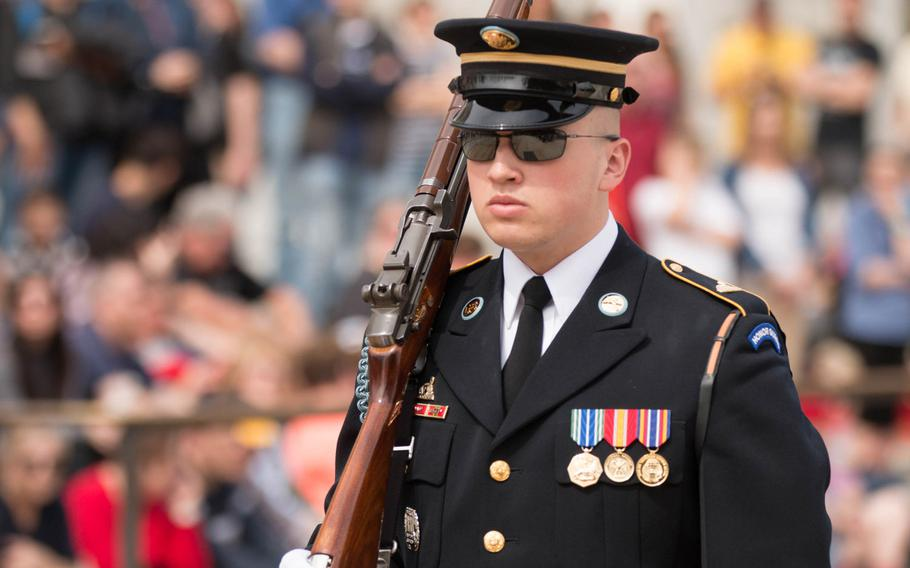 """A member of the U.S. Army's 3rd Infantry Regiment """"The Old Guard"""" walks his post outside the Tomb of the Unknown Soldier at Arlington National Cemetery on March 25, 2017."""