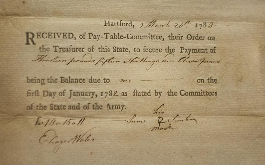 A voucher of payment to former slave Pvt. Prince Simbo, for services rendered during the Revolutionary War. The voucher, dated 1783, is for 13 pounds and 15 shillings. An inside look at the military section at the National Museum of African American History in Washington, D.C., on March 28, 2017.