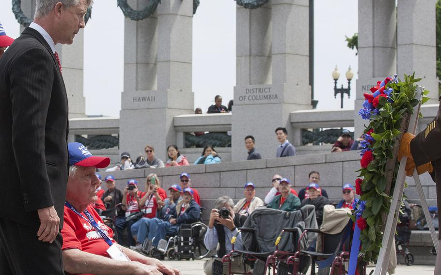 Representing the Kansas Honor Flight, Congressman Roger Marshell and World War II, Korea and Vietnam veteran Ewin Aley place a wreath during the Battle of the Coral Sea 75th Anniversary at the World War II Memorial in Washington, D.C., May 4, 2017.