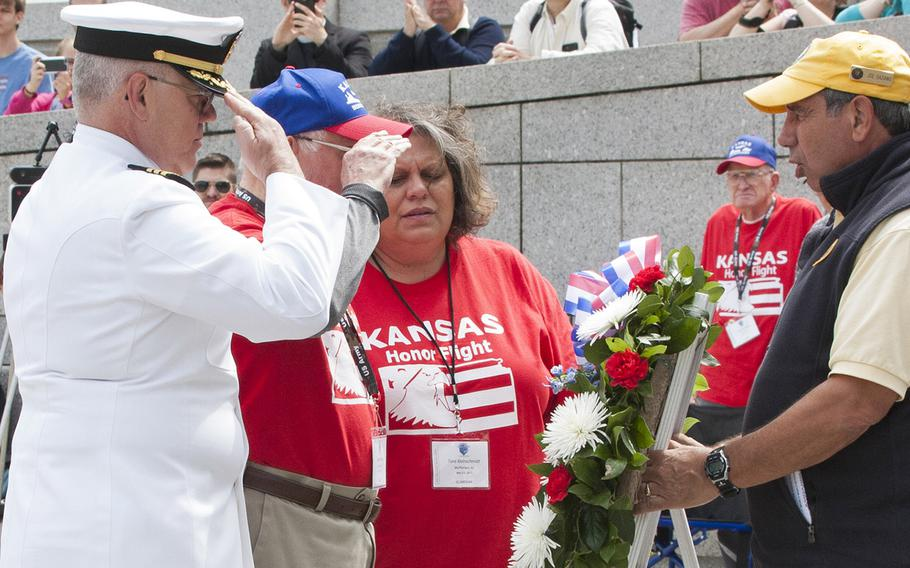 Navy Chaplain Commander Michael Pumphrey lays a wreath with World War II veteran Charles Friedley during the Battle of the Coral Sea 75th Anniversary Commemoration at the World War II Memorial in Washington, D.C., on May 4, 2017. Friedley was a paratrooper in the 82nd Airborne. Pumphrey and Friedley were representing the United States during the ceremony.