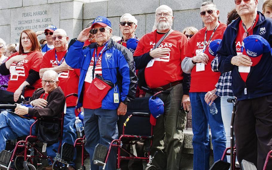 Veterans with the Kansas Honor Flight salute at the start of the Battle of the Coral Sea 75th Anniversary Commemoration at the World War II Memorial in Washington, D.C., on May 4, 2017.
