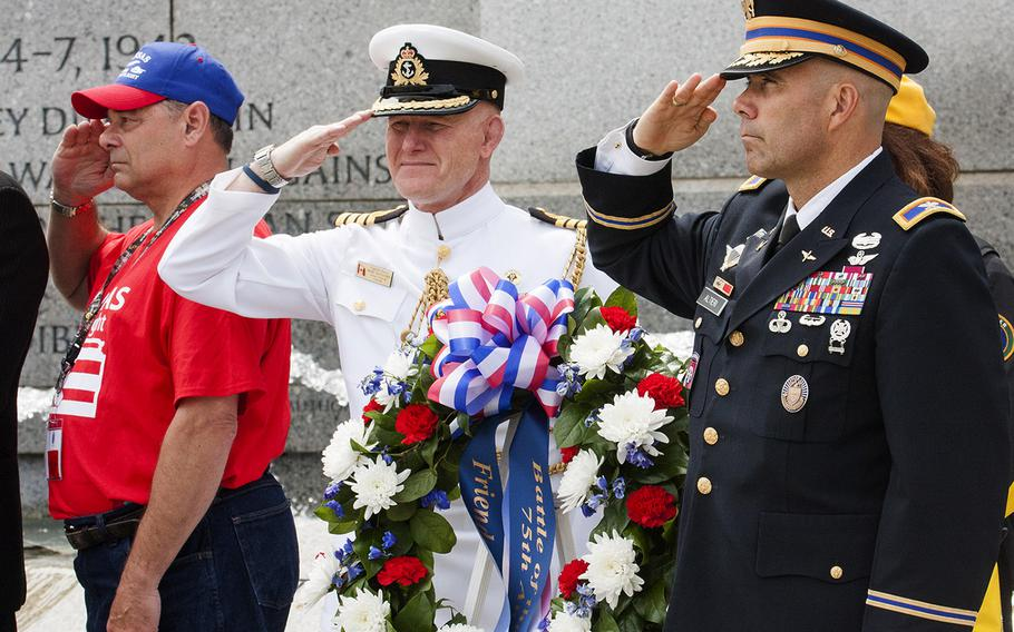Col. Jayson Altieri, US Army, and Capt. Marc Batsford, Canadian Forces Naval attache, salute at the Battle of the Coral Sea 75th Anniversary at the World War II Memorial in Washington, D.C., on May 4, 2017. At the far left is the guardian for honor flight participant Ewin Aley.