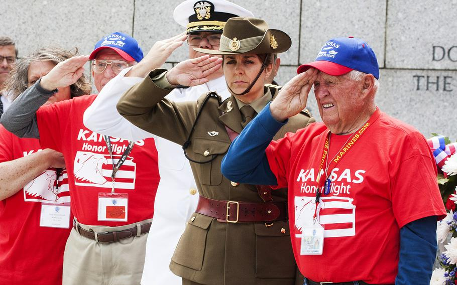 From left to right, World War II veteran Charles Friedley, Navy Chaplain Commander Michael Pumphrey, Lt. Col.Melissa Campbell from the Australian defense staff, and World War II veteran Loyal Shirley salute during The Battle of the Coral Sea 75th Anniversary Commemoration at the World War II Memorial in Washington, D.C., on May 4, 2017.