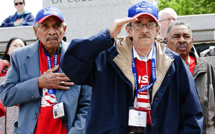 Al Waszczyseyn, foreground, and other Air Force veterans with the Kansas Honor Flight salute at the start of the Battle of the Coral Sea 75th Anniversary Commemoration at the World War II Memroail in Washington, D.C., on May 4, 2017.