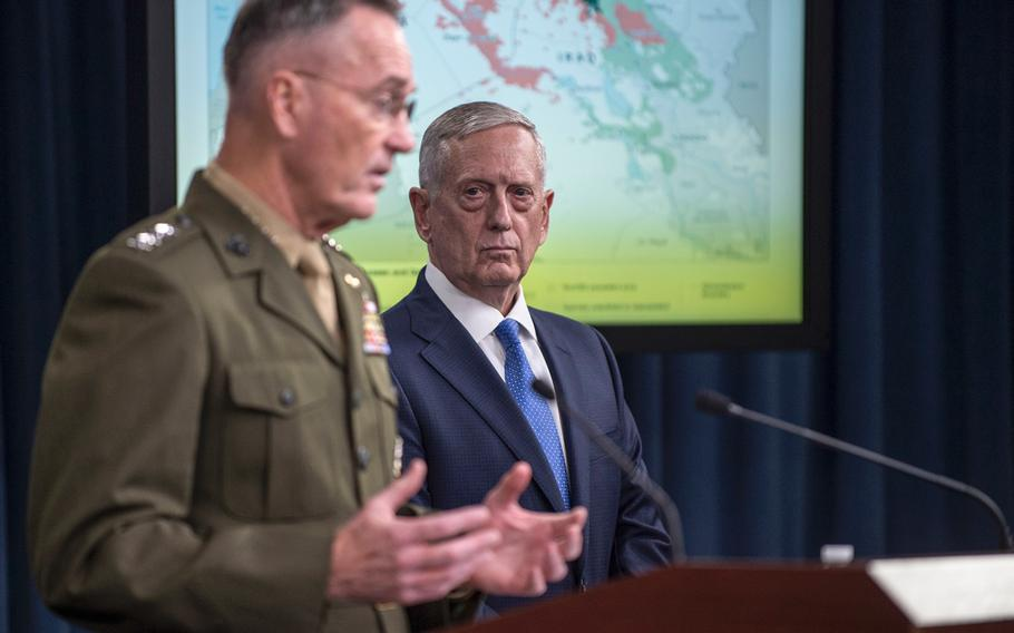 Defense Secretary Jim Mattis and Marine Gen. Joseph Dunford, the Chairman of the Joint Chiefs of Staff, attend a May 19, 2017, briefing at the Pentagon where they gave an update on the fight against the Islamic State.