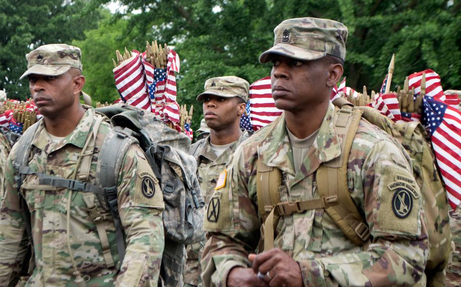 Soldiers with the 3rd U.S. Infantry Regiment (The Old Guard) prepare to place flags at Arlington National Cemetery during Flags In on May 25, 2017.