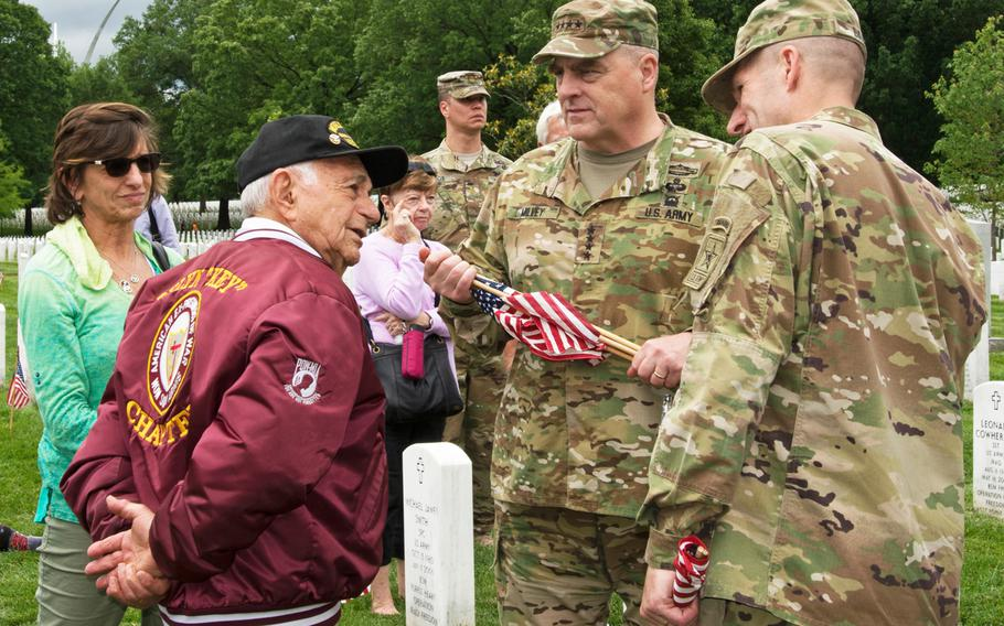 World War II veteran Harold Radish talks with Army Chief of Staff Gen. Milley during Flags In at Arlington National Cemetery on May 25, 2017.