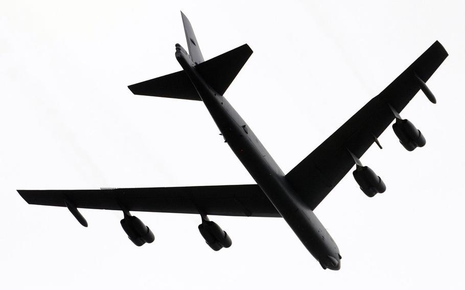 A B-52 bomber roars over Arlington National Cemetery on Sunday, May 28, 2017.