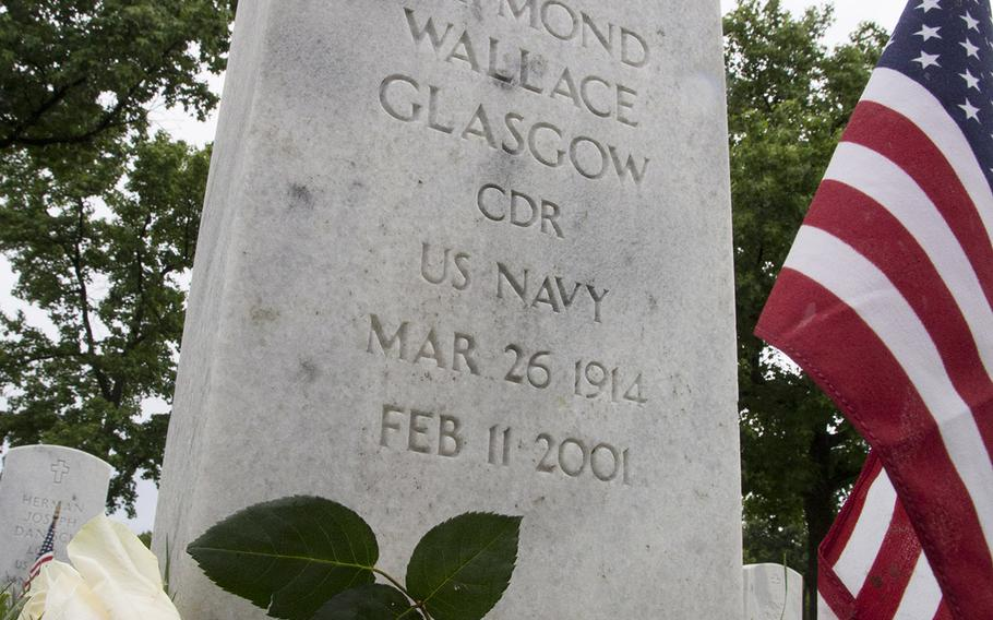 A rose and a flag adorn an Arlington National Cemetery grave in preparation for Memorial Day, Sunday, May 28, 2017.