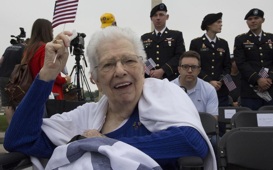 Betty Kearl, wife of World War II Navy veteran Clayton Kearl, waves a flag before Monday's Memorial Day ceremony at the National World War II Memorial in Washington, D.C. Clayton Kearl served on the USS Salt Lake City during the war.