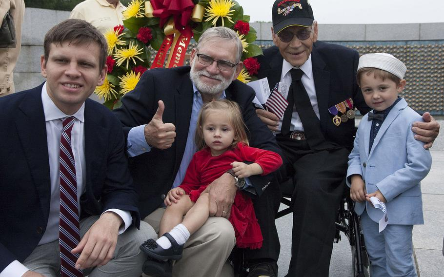 World War II veteran Edward Kachinske poses with family members, from left, grandson Adam, son Timothy with great-granddaughter Jovana and great-grandson Vasily at the National World War II Memorial in Washington, D.C., on Memorial Day 2017.