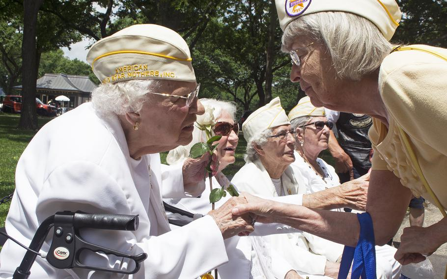 Gold Star Mother Emogene Cupp greets someone who stopped as they passed by on Memorial Day, May 29, 2017.