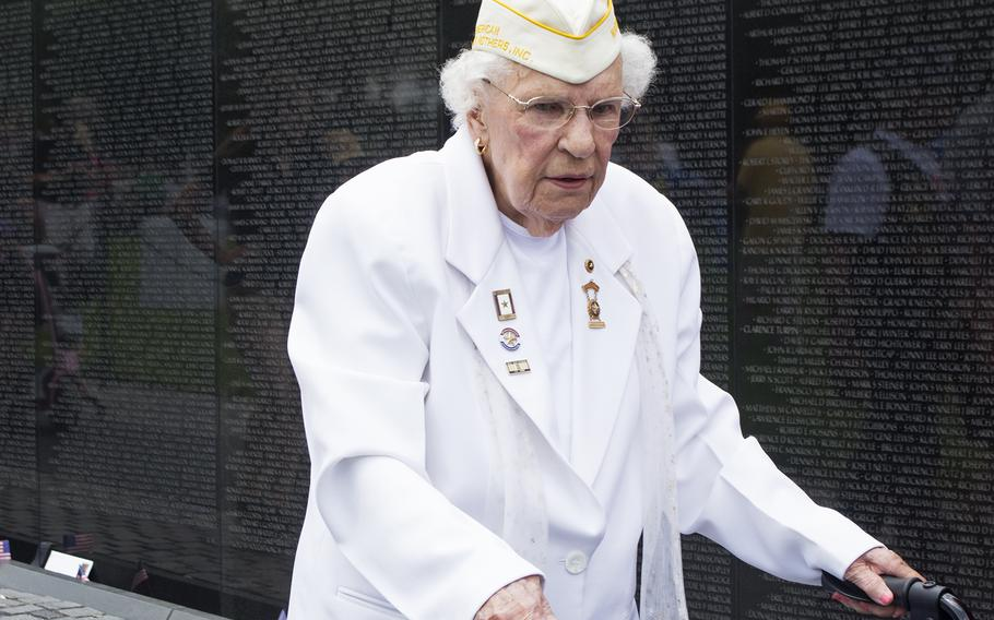Emogene Cupp walks along the Vietnam Wall at the start of the Memorial Day ceremony on May 29, 2017.