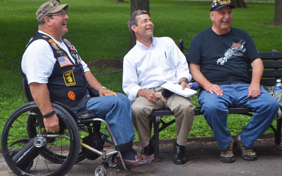 Dennis Mason chats with a reporter from ABC and another Vietnam veteran  near the Vietnam Wall in Washington, D.C., on May 29, 2017.