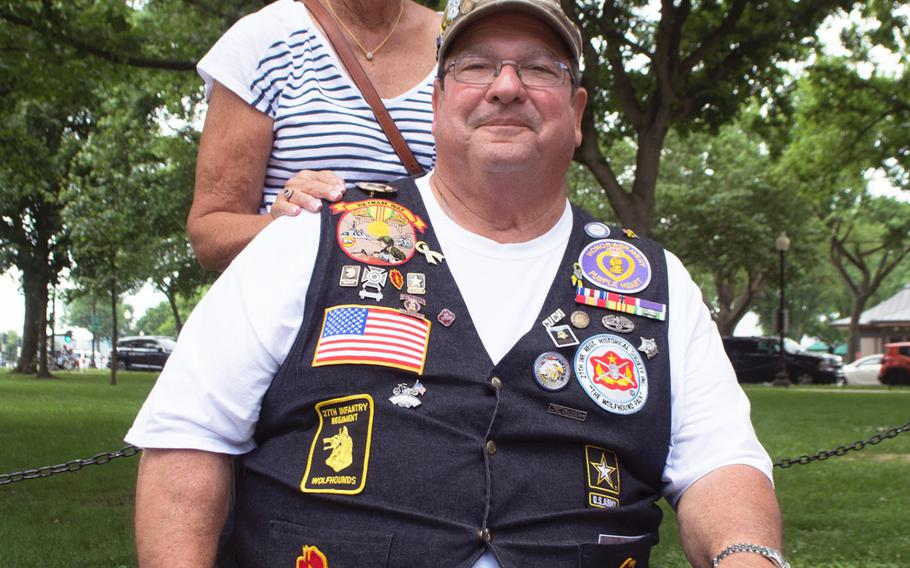 Dennis Mason and his wife Juliet pose near the Vietnam Wall in Washington, D.C., on May 29, 2017.