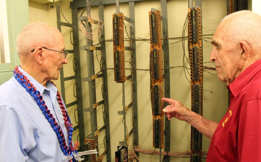 John F. Miniclier, left, and Edgar R. Fox, U.S. Marines who served at the Battle of Midway, examine a message routing switchboard during a tour June 2, 2017, of the former Station Hypo in Building I of the Pearl Harbor Naval Shipyard and Intermediate Maintenance Facility, Hawaii. The board is one of the few remaining relics of the basement that served as the secretive workplace of the band of cryptologists who broke the Japanese code in March 1942, which gave the U.S. a huge advantage.